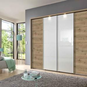 Schwebetürenschrank in Plankeneiche-Nb./Glas weiß., mit Syncro-Technik, 3 Einlegeböden und 3 Kleiderstangen, Maße: B/H/T ca. 270/210/65 cm