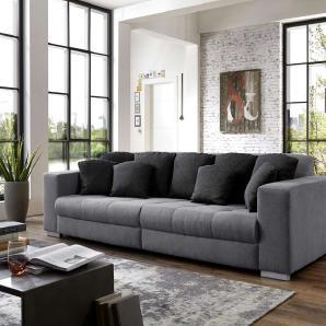 Big Sofa mit Korpus und Sitzfläche in Microfaser grau, Kissen schwarz-grauer Strukturstoff, Füße aus silberf. Holz, Maße: B/H/T ca. 288/78/124 cm